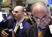 Traders work on the floor of the New York Stock Exchange, March 27, 2012. REUTERS/Brendan McDermid