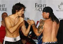 Liberal Member of Parliament Justin Trudeau (L) and Conservative Senator Patrick Brazeau pose after weighing-in for a charity boxing match in Ottawa March 28, 2012. REUTERS/Chris Wattie