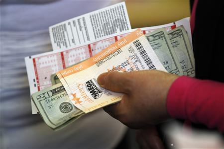 Who are the lucky 3 to share record $656 million U S  lottery? - Reuters