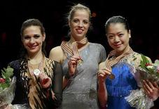 (L-R) Alena Leonova of Russia, Carolina Kostner of Italy and Akiko Suzuki of Japan celebrate on the podium during the medal ceremony at the women's free skating event at the ISU World Figure Skating Championships in Nice March 31, 2012. REUTERS/Eric Gaillard