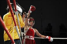 Liberal Member of Parliament Justin Trudeau celebrates after defeating Conservative Senator Patrick Brazeau during their charity boxing match in Ottawa March 31, 2012. REUTERS/Chris Wattie