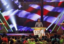 First lady Michelle Obama speaks on stage at Nickelodeon's 25th annual Kids' Choice Awards in Los Angeles, California March 31, 2012. REUTERS/Mario Anzuoni