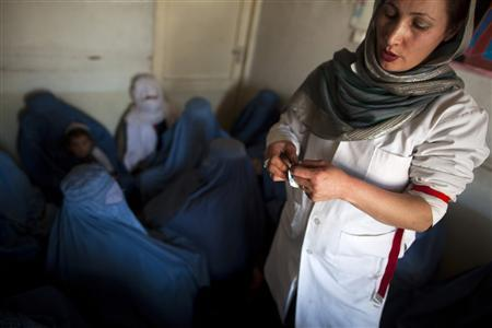 An Afghan doctor explains the use of condoms to a group of women addicts at a counseling session at the Nejat drug rehabilitation centre, an organisation funded by the United Nations providing harm reduction and HIV-AIDS awareness, in Kabul January 29, 2012. With little funding and no access to substitution drugs such as methadone, treatment is rudimentary at Nejat for a problem that is growing in a dirt-poor country riven by conflicts for more than three decades. Opiate consumption in Afghanistan, where it has long been a medication but in recent years has been used increasingly for recreation, is also on a sharp rise. Nejat estimates around 60,000 women in Afghanistan regularly take illegal drugs, including hashish and marijuana. Shrouded in stigma, female drug users is a topic that is almost never mentioned in Afghanistan. Picture taken January 29, 2012. REUTERS-Ahmad Masood