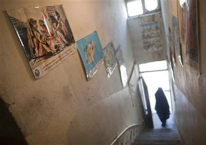 A woman clad in burqa walks out of the Nejat drug rehabilitation centre, an organisation funded by the United Nations providing harm reduction and HIV-AIDS awareness, in Kabul January 29, 2012. With little funding and no access to substitution drugs such as methadone, treatment is rudimentary at Nejat for a problem that is growing in a dirt-poor country riven by conflicts for more than three decades. Opiate consumption in Afghanistan, where it has long been a medication but in recent years has been used increasingly for recreation, is also on a sharp rise. Nejat estimates around 60,000 women in Afghanistan regularly take illegal drugs, including hashish and marijuana. Shrouded in stigma, female drug users is a topic that is almost never mentioned in Afghanistan. Picture taken January 29, 2012. REUTERS-Ahmad Masood