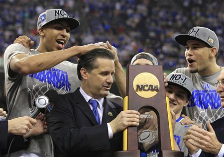 Kentucky Wildcats forward Anthony Davis (L) messes up the hair of head coach John Calipari as he holds the championship trophy after the Wildcats defeated the Kansas Jayhawks in the men's NCAA Final Four championship college basketball game in New Orleans, Louisiana, April 2, 2012. REUTERS/Lucy Nicholson