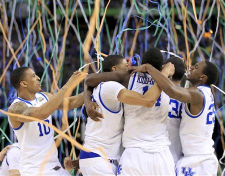 Kentucky Wildcats guard Twany Beckham (L) celebrates with his teammates after the Wildcats defeated the Kansas Jayhawks to win their men's NCAA Final Four championship college basketball game in New Orleans, Louisiana, April 2, 2012. REUTERS/Lucy Nicholson
