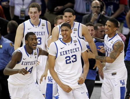 Kentucky Wildcats' Anthony Davis (23), Michael Kidd-Gilchrist (14) and teammates celebrate after the Wildcats defeated the Kansas Jayhawks to win the men's NCAA Final Four championship college basketball game in New Orleans, Louisiana, April 2, 2012. REUTERS/Jonathan Bachman