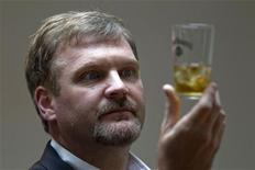 Jeff Arnett, master distiller at the Jack Daniel's distillery, looks at a glass of whiskey as he poses during an interview with Reuters in Paris September 9, 2010. REUTERS/Charles Platiau
