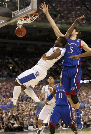 Kentucky Wildcats forward Michael Kidd-Gilchrist (L) falls while driving to the net on Kansas Jayhawks center Jeff Withey during the first half of their men's NCAA Final Four championship college basketball game in New Orleans, Louisiana, April 2, 2012. REUTERS/Jeff Haynes