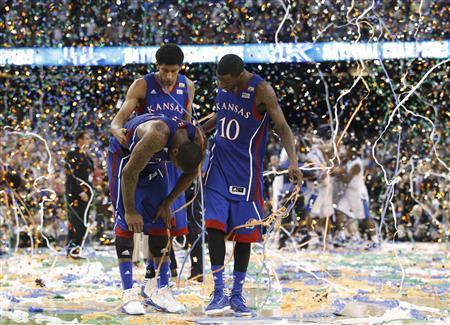 Kansas Jayhawks forward Thomas Robinson (L) is consoled by Kevin Young and Tyshawn Taylor after they were defeated by the Kentucky Wildcats in the men's NCAA Final Four championship college basketball game in New Orleans, Louisiana, April 2, 2012. REUTERS/Jeff Haynes
