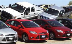 A row of Ford Focus (bottom) are displayed next to Ford F-Series pickups at Koons Ford in Silver Spring, Maryland April 3, 2012. U.S. auto sales rose more than 15 percent in March, preliminary data showed, as rising consumer confidence and cheap financing quickened the pace of a sluggish recovery more than two years in the making. REUTERS/Gary Cameron