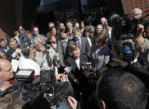 Mary Bonuato (C), civil rights project director at Boston-based Gay & Lesbian Advocates and Defenders (GLAD), speaks to reporters outside the U.S. District Court after attending a hearing before a federal appeals court panel on the Defense of Marriage Act in Boston, Massachusetts April 4, 2012. A federal appeals court in Boston heard arguments on Wednesday about the constitutionality of a law that denies federal benefits to married same-sex couples - a case with implications for gay marriage across the United States. REUTERS/Jessica Rinaldi