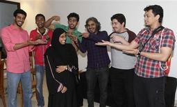 Members of the Uturn comedian pose for picture in Jeddah March 26, 2012. REUTERS/Susan Baaghil (