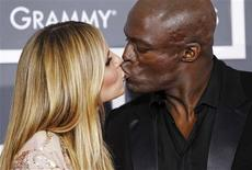 Model Heidi Klum and singer Seal kiss on the red carpet at the 52nd annual Grammy Awards in Los Angeles in this January 31, 2010 file photo. Supermodel and TV host Heidi Klum on April 6, 2012, filed for divorce from her husband, the singer Seal, following the pair's separation earlier this year, a representative for Klum said. REUTERS/Mario Anzuoni/Files