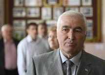 Presidential candidate Leonid Tibilov looks on after voting as he visits a polling station in Tskhinvali, in the breakaway region of South Ossetia April 8, 2012. REUTERS/Kazbek Basayev