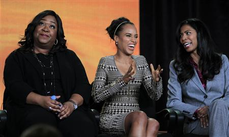Executive Producer Shonda Rhimes (L-R), actress Kerry Washington, and Co-Executive Producer Judy Smith of the television series ''Scandal'' take part in a panel session at the ABC Winter TCA Press Tour in Pasadena, California in this January 10, 2012 file photograph. Washington's lead role as a crisis management expert has not only won the actress over to television, but it's also the first drama series on a major broadcast TV network in recent memory to star a black actress in the lead role. Picture taken January 10, 2012. REUTERS/Lucy Nicholson/Files