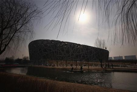 Workers remove rubbish from the canal running past the National Stadium, also known as the ''Bird's Nest'', which was the venue for the athletics and the opening and closing ceremonies of the 2008 Olympic Games in Beijing March 23, 2012. The gigantic infrastructures built for the Beijing Olympics, namely the ''Bird's Nest'', and the National Aquatics Centre, also known as the ''Water Cube'', are now used for cultural and sports events, reminding the world of the flare that blazed during the summer of 2008. However, some other Beijing Olympic venues, such as the rowing and kayaking centre, baseball arena and BMX track, have been left either deserted or been completely demolished. Picture taken March 23, 2012. REUTERS/David Gray
