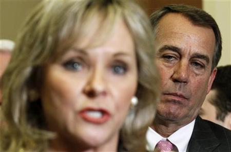 House Speaker-designate John Boehner (R) listens as Oklahoma Governor-elect Mary Fallin speaks in Washington December 1, 2010. REUTERS/Kevin Lamarque