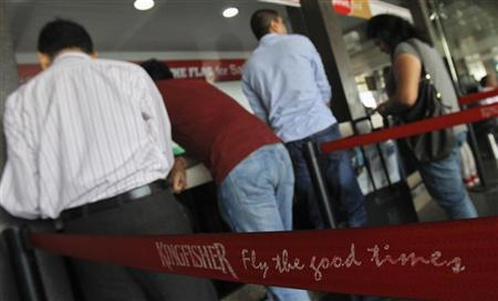 Customers stand at a Kingfisher Airlines reservation office at the domestic airport in Mumbai February 16, 2012. REUTERS/Vivek Prakash/Files