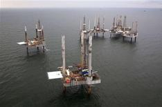Unused oil rigs sit in the Gulf of Mexico near Port Fourchon, Louisiana in this August 11, 2010 file photo. G REUTERS/Lee Celano/Files