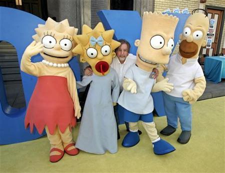 Matt Groening (C), creator of the Fox television network animated television series ''The Simpsons'', poses with characters (L-R) Lisa, Maggie, Bart and Homer Simpson as he arrives for a block party on the Fox studio lot celebrating the series 350th episode in Los Angeles April 25, 2005.