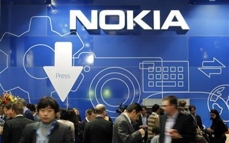People visit the Nokia area at the Mobile World Congress in Barcelona February 28, 2012. REUTERS/Albert Gea/Files