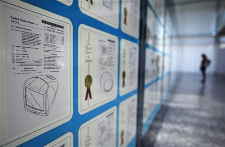 A visitor looks at Apple patents displayed at the World Intellectual Property Organization (WIPO) headquarters in Geneva March 29, 2012. REUTERS/Denis Balibouse
