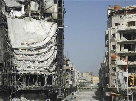 Buildings damaged by the government army, according to the opposition, are seen at Juret al-Shayah, in Homs April 10, 2012. REUTERS/Shaam News Network/Handout