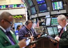 Traders work on the floor of the New York Stock Exchange April 11, 2012. REUTERS/Brendan McDermid