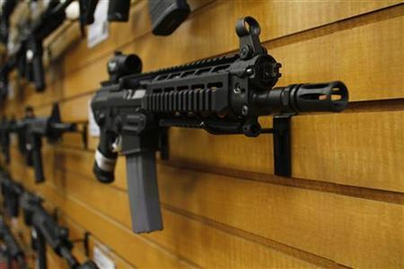 An automatic weapon is displayed on a wall at the Scottsdale Gun Club in Scottsdale, Arizona December 10, 2011. REUTERS/Joshua Lott/Files