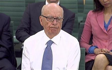 News Corp Chief Executive and Chairman Rupert Murdoch sits without his jacket after being attacked with shaving cream, during a parliamentary committee hearing on phone hacking at Portcullis House in London July 19, 2011. REUTERS/Parbul TV via Reuters Tv/Files
