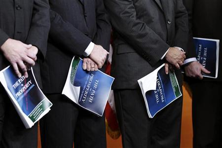 U.S. Republican congressmen hold copies of ''The FY2013 Budget - The Path to Prosperity'' which was unveiled by House Budget Chairman Paul Ryan (R-WI) during a news conference at Capitol Hill in Washington March 20, 2012. REUTERS/Jose Luis Magana