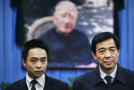 China's former Chongqing Municipality Communist Party Secretary Bo Xilai (R) and his son Bo Guagua stand in front of a picture of his father Bo Yibo, former vice-chairman of the Central Advisory Commission of the Communist Party of China, at a mourning hall in Beijing in this January 18, 2007 file photo. REUTERS/Stringer