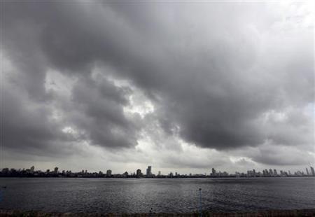 Clouds gather over the Mumbai skyline June 21, 2010. REUTERS/Rupak De Chowdhuri/Files