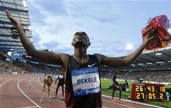 Kenenisa Bekele of Ethiopia celebrates after winning the 10000 metres race at the Memorial Van Damme, IAAF Diamond League athletics meeting in Brussels, September 16, 2011.  REUTERS/Francois Lenoir