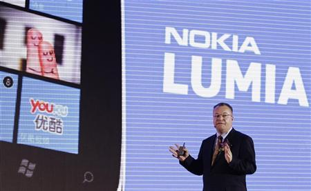 Nokia's President and CEO Stephen Elop gestures as he speaks during a news conference for the launch of the new Nokia Lumia products in Beijing, March 28, 2012. REUTERS/Soo Hoo Zheyang