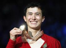 Patrick Chan of Canada celebrates during the medal ceremony after winning the men's event at the ISU World Figure Skating Championships in Nice March 31, 2012. REUTERS/Jean-Paul Pelissier