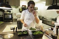 Chef and owner Wojciech Amaro tastes food in the kitchen of his restaurant Atelier Amaro in the center of Warsaw April 13, 2012. REUTERS/Kacper Pempel