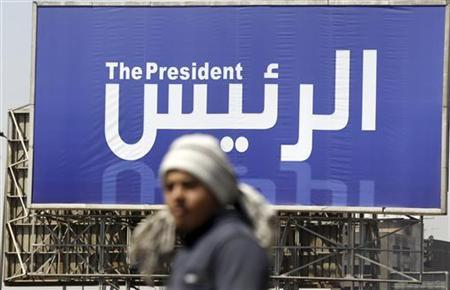 A man walks past a banner publicising the presidential election in Cairo April 5, 2012. REUTERS/Amr Abdallah Dalsh