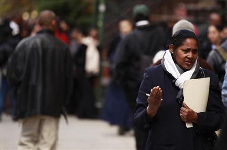 A woman holds her resume as she waits in a line of job seekers waiting to attend the Dr. Martin Luther King Jr. career fair held by the New York State department of Labor in New York, April 12, 2012. REUTERS/Lucas Jackson