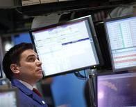 Traders work on the floor of the New York Stock Exchange, April 17, 2012. REUTERS/Brendan McDermid