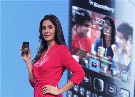 Bollywood actress Katrina Kaif poses with the newly launched BlackBerry Curve 9220 smartphone in New Delhi April 18, 2012. Research in Motion (RIM) on Wednesday launched in India what it called its ''most affordable'' BlackBerry smartphone, part of an aggressive push in one of its few growing markets. The new Curve 9220 is priced in India at 10,990 rupees ($210), higher than the price of Curve 8520, which is RIM's best-selling phone in India, and comes with an introductory offer to download free applications worth 2,500 rupees. REUTERS/Adnan Abidi