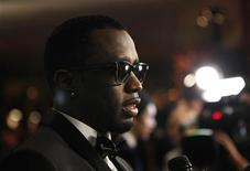 """Sean """"P. Diddy"""" Combs is being interviewed at the 13th annual Warner Bros and InStyle after party after the 69th annual Golden Globe Awards in Beverly Hills, California January 15, 2012. REUTERS/Mario Anzuoni"""
