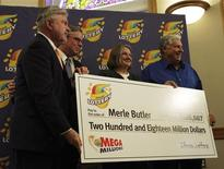 Mega Millions Jackpot winner Merle Butler (R) and his wife Patricia pose with their check along with Red Bud Mayor Tim Lowry (L) and Illinois Lottery superintendent Michael Jones during a press conference at Red Bud City Hall in Red Bud, Illinois, April 18, 2012. REUTERS/Illinois Lottery/Handout