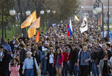 Supporters of former mayoral candidate Oleg Shein march during a protest rally in the south Russian city of Astrakhan April 14, 2012. Shein, claiming his victory was stolen in favor of a rival from Vladimir Putin's United Russia party, has vowed not to eat until a new vote is held in this provincial capital in southern Russia. REUTERS/Vladimir Tyukaev