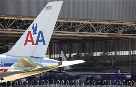 An American Airlines airliner sits near a hanger at Dallas/Fort Worth International Airport, Texas April 4, 2012. REUTERS/Tim Sharp