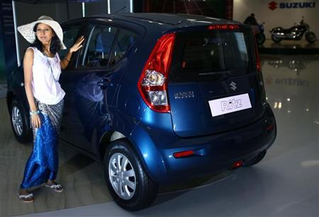 A model poses with 'Ritz' car during its launch in New Delhi May 15, 2009. REUTERS/Vijay Mathur/Files