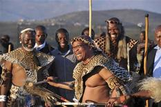 """South African President Jacob Zuma dances as he marries his fiancee Bongi Ngema at a traditional ceremony known as """"Umgcagco"""" at his home in Nkandla, in South Africa's KwaZulu Natal province, in this handout picture supplied by the Government Communication and Information Service, April 20, 2012. REUTERS/Elmond Jiyane/GCIS/Handout"""