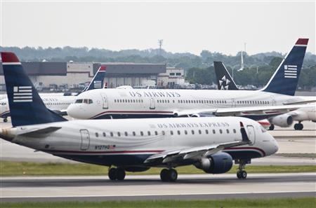 US Airways jets taxi on the tarmac in Charlotte, North Carolina April 20, 2012. REUTERS/Chris Keane