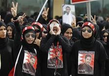 Protesters, wearing t-shirts with an image of Bahraini human rights activist Abdulhadi Al-Khawaja, shout anti-government slogans as they protest during a rally by Bahrain's main opposition party Al Wefaq in Budaiya, west of Manama, April 20, 2012. REUTERS/Hamad I Mohammed